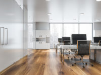 Open space office interior with bookcases