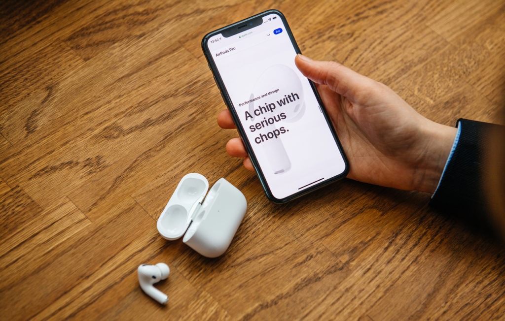 Woman testing latest Apple Computers AirPods Pro headphones