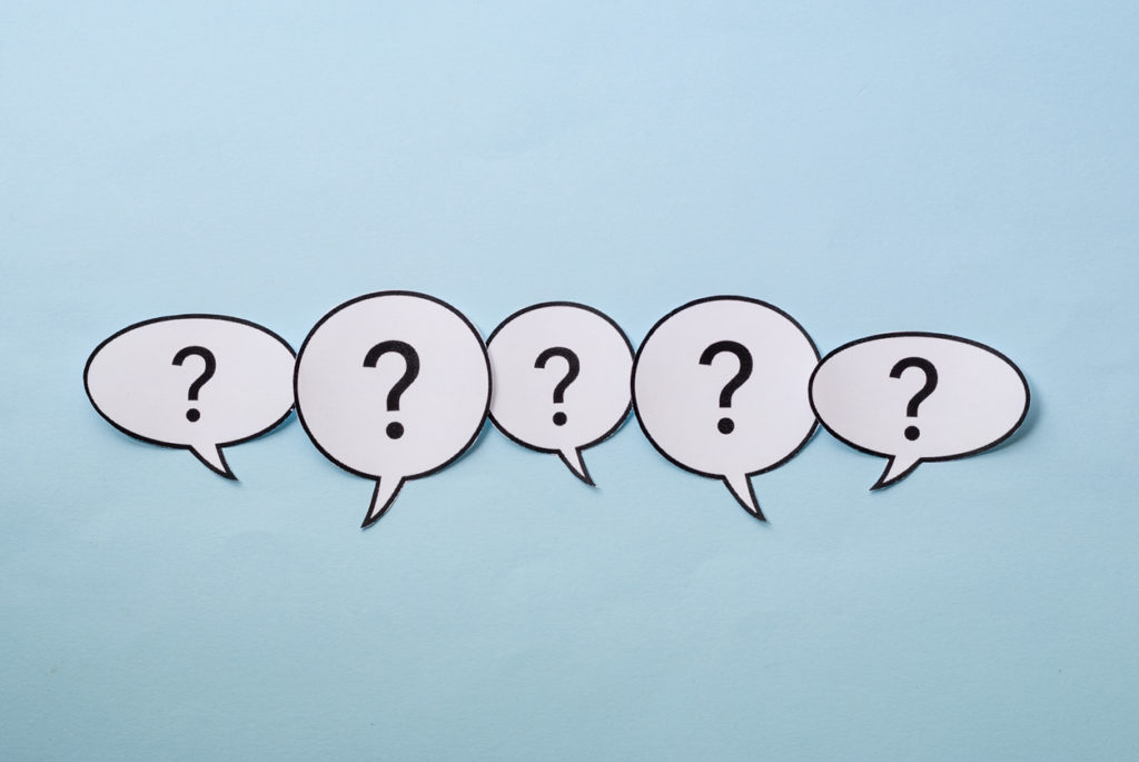 Line of question marks in speech bubbles