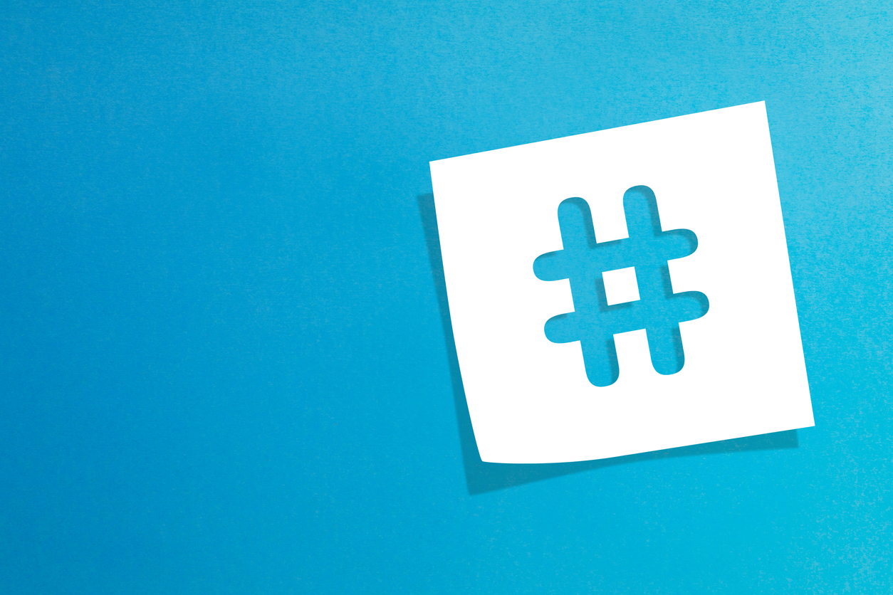 Hashtag sign on white information paper