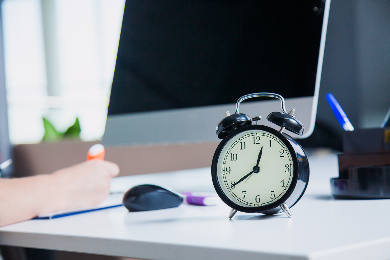 Time management concept in business office