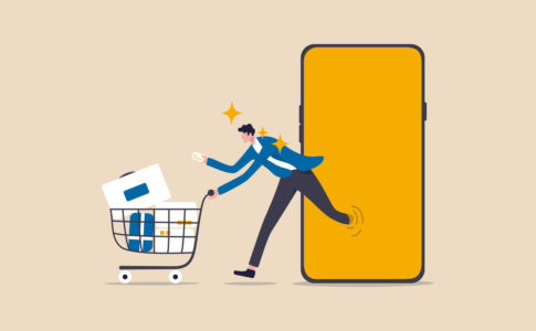 Online shopping or mobile shopping app concept, young man consumer holding credit cart pushing full of goods and box packages in shopping cart trolley running from website or app on mobile smart phone