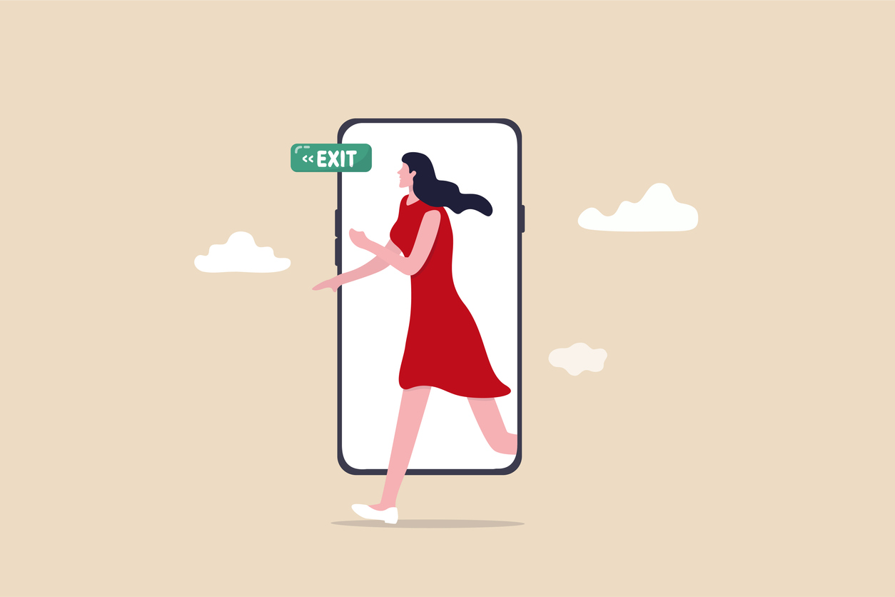 Reduce mobile screen time, digital detox, exit from virtual social media and live your real life concept, happy young woman walking step out of smartphone mobile screen follow green exit sign.