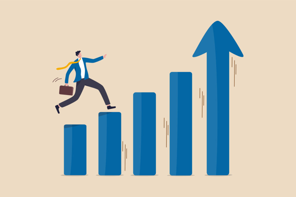 Economic prosperity, business profit growth or career path and income increase concept, confidence smart businessman jumping on moving up bar graph with rising up arrow as ladder of success.