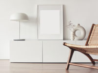 Blank picture frame mockup on white wall. Living room design